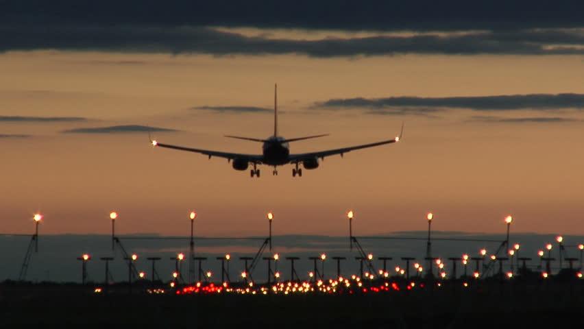 Jet Landing at Dublin Airport at Dusk
