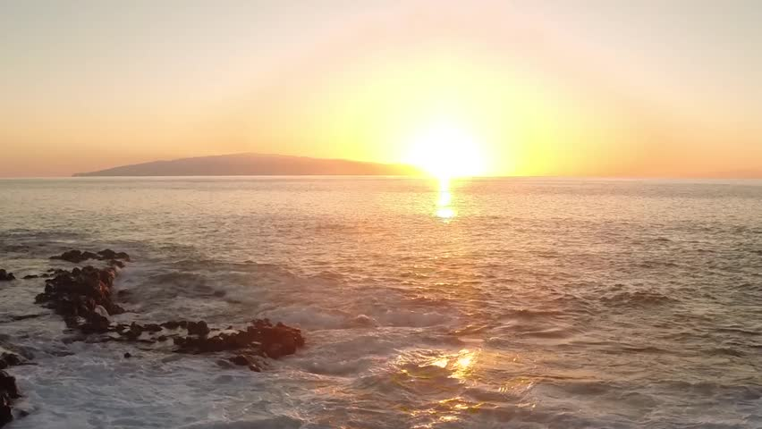 Sunset on the Atlantic Ocean. The sun sets over the island of La Gomera. Off the island of Tenerife. Time-lapse.