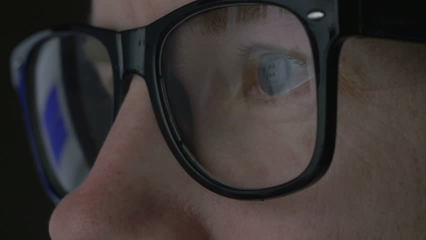 Caucasian man web shopping jackets and the screen is reflected in the glasses. closeup shot | Shutterstock HD Video #15499798