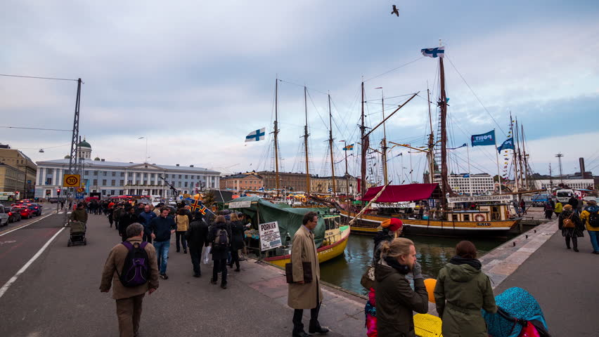 HELSINKI - 20 OCT: Timelapse vide of a waterfront market with boats selling items Market Square is Helsinki's most international and famous market on 20 October 2014 in Helsinki, Finland