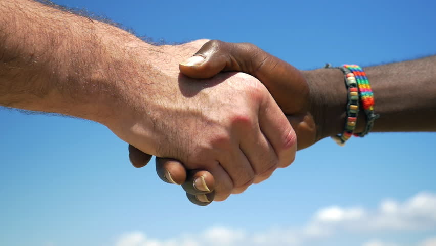 Slow motion close-up shot of European and African men shaking hands on blue sky background. International or interracial relations and friendship  Royalty-Free Stock Footage #15518530