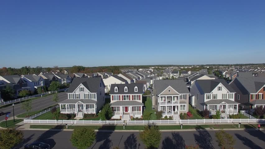 An aerial establishing video of a suburban neighborhood, 4K UHD | Shutterstock HD Video #15529465