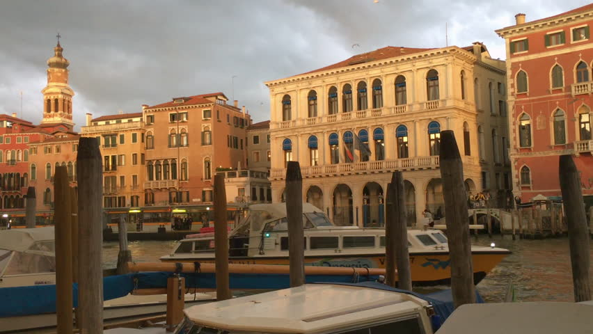 VENICE ITALY 4 OCT 2015: grand canal view. Europe travel and tourism background. Italian architecture during cloudy sunset. Venetian cityscape, street buildings landmarks. Famous Venezia, sky clouds | Shutterstock HD Video #15530545
