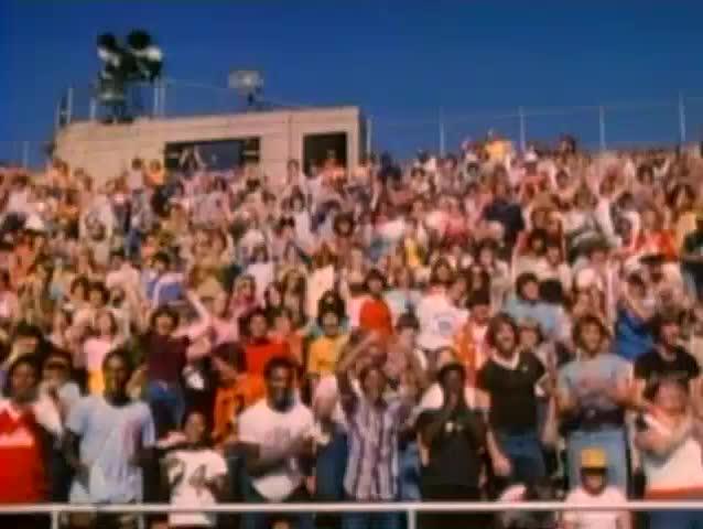Spectators cheering in bleachers, 1980