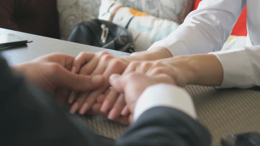 Girl holds the hand of her boyfriend. Close-up | Shutterstock HD Video #15568396