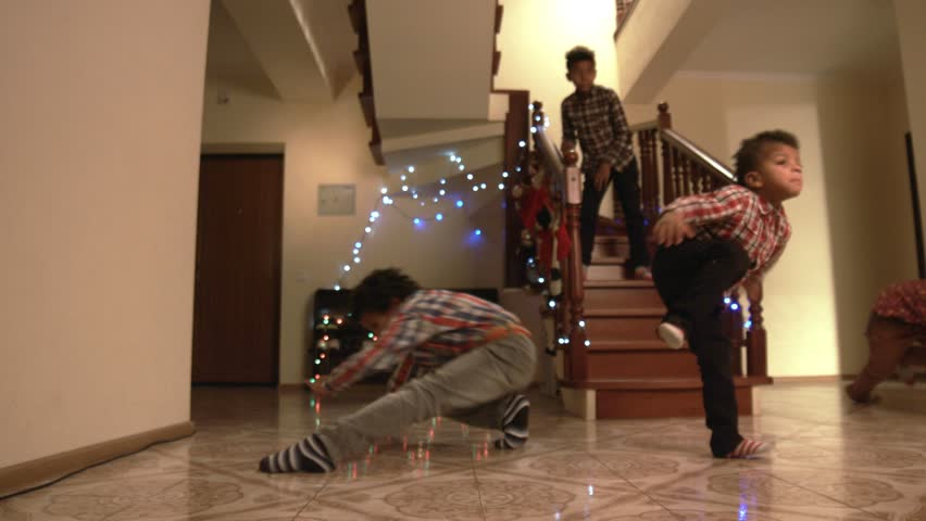 Young boys' Christmas dance. Kids breakdancing on the floor. Complexes don't exist. Young gentlemen demonstrating nice moves. #15588325