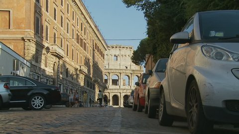 ROME, ITALY. AUGUST 16 2013. Walking The Streets, Colosseum In Distance 2 (Slow Motion Dolly)