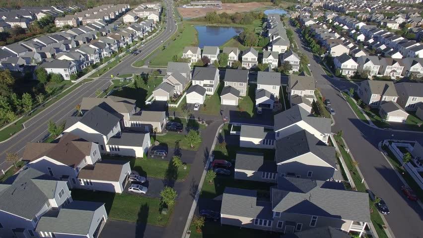An aerial establishing shot of a suburban neighborhood, 4K UHD | Shutterstock HD Video #15624994