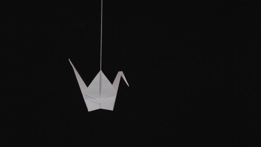 White Paper Origami Crane Swinging Stock Footage Video (100