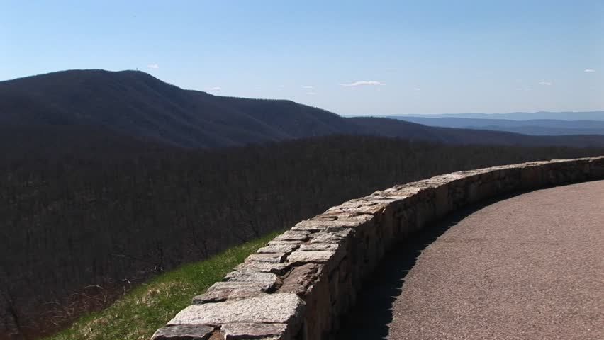Wide shot of a low stone wall along a road in the Blue Ridge Mountains of Virginia. | Shutterstock HD Video #1566103