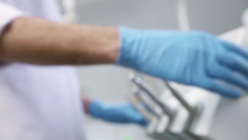 The dentist adjusts the equipment before the patient reception | Shutterstock HD Video #15667312