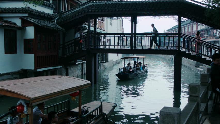 Shanghai Zhujiajiao water village FangSheng bridgeBridge over the canals in the water village of ZhuJiaJiao near Shanghai. | Shutterstock HD Video #15723874