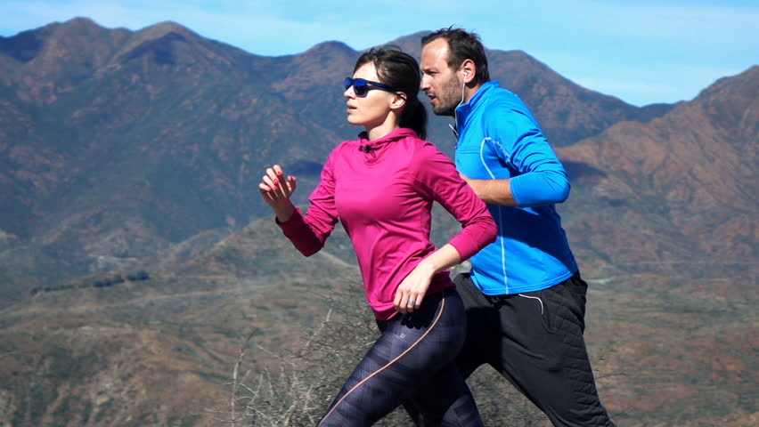 Young couple jogging in country, super slow motion 240fps  | Shutterstock HD Video #15726100