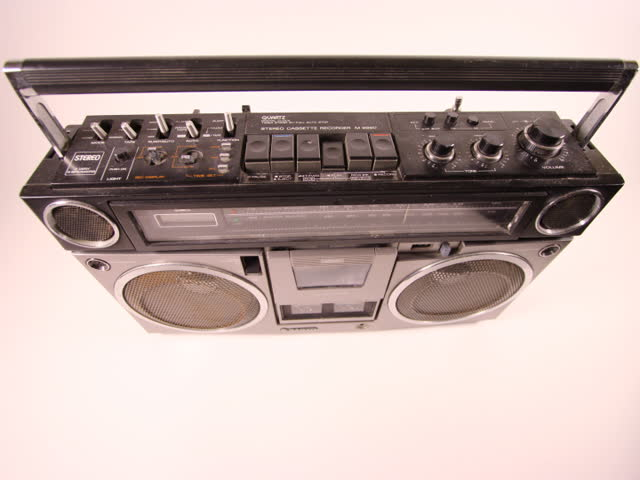 ghetto blaster spits out cassette tape