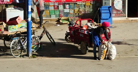 Oct 09,2015:4k busy traffic & crowd in Shangri-La street,yunnan china.Fruit stand & Minority women. gh2_10545_4k