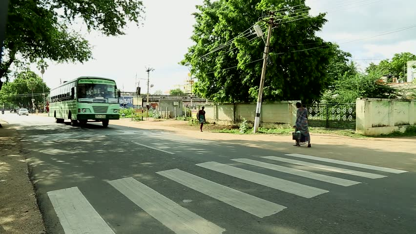 TIRUPPATUR, INDIA - NOVEMBER 15th, 2015: Bus and People crossing the street-India.   Shutterstock HD Video #15767254