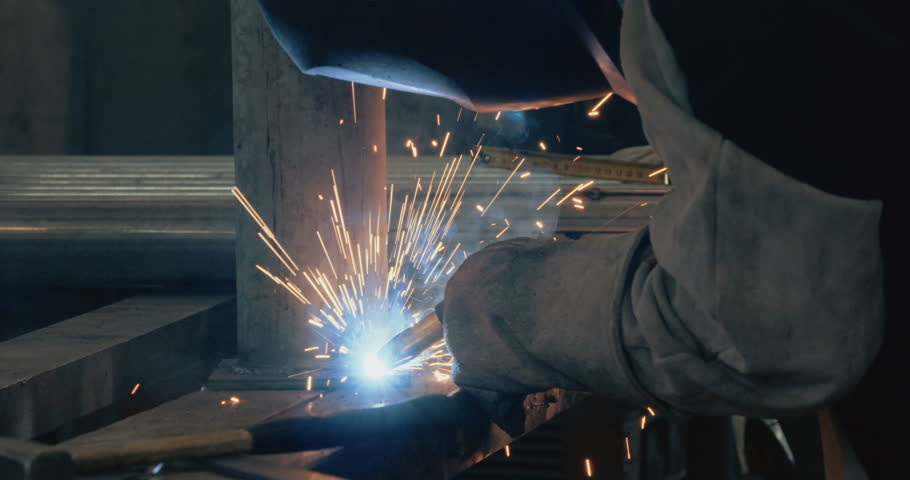 Welder working and soldering iron with mask   Shutterstock HD Video #15768499
