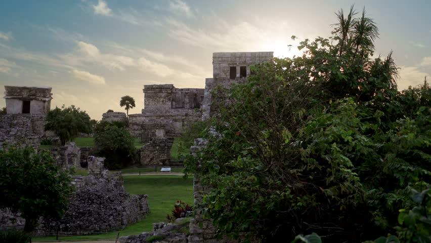beautiful sunrise over tulum mayan ruins temple