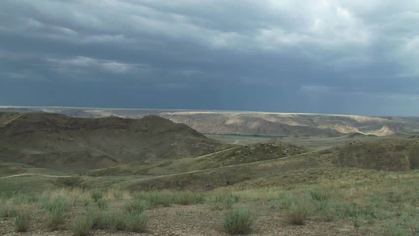 Blue storm clouds over the rocks in the desert. blue river. panorama from left to right | Shutterstock HD Video #15775798
