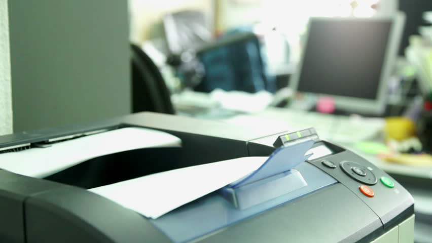 Printing document paper with laser printer. Office work and furnishings, stationery around in the background is seen the monitor #15792346