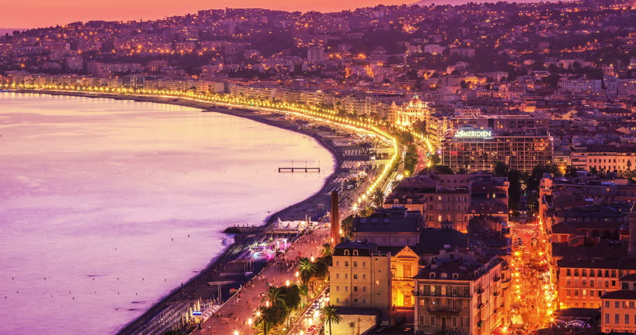 Timelapse of Nice panorama, cityscape at sunset with traffic street and building rooftop/Night Aerial Skyline Nice Luxury Travel Tourism French Riviera France European