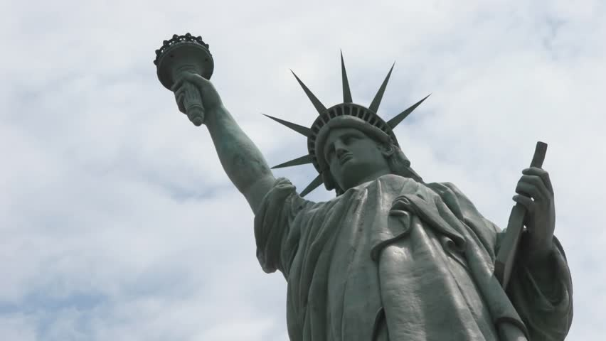 Statue of Liberty stands in front of time-lapse clouds circa 2006 in New York. | Shutterstock HD Video #1579477