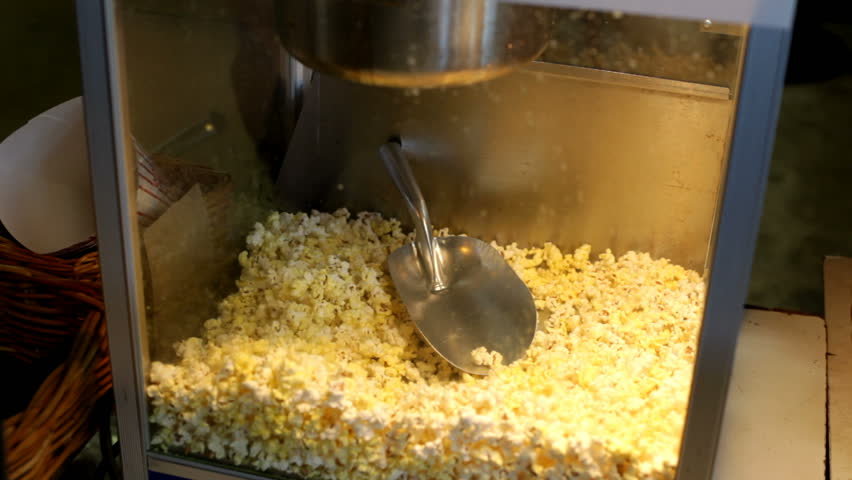 Popcorn scooped from machine
