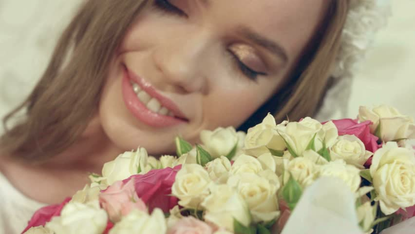 Portrait of beautiful girl posing with a big bouquet of delicate roses #15809815