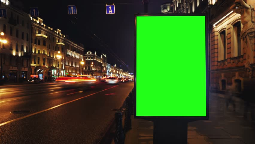 A Billboard with a Green Screen on a Busy Night Street.Time Lapse.