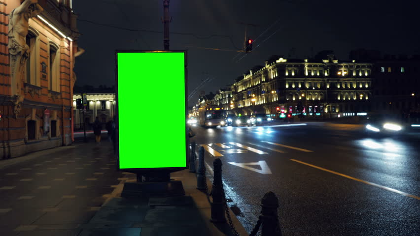 A Billboard with a Green Screen on a Busy Night Street.Time Lapse.   Shutterstock HD Video #15819580