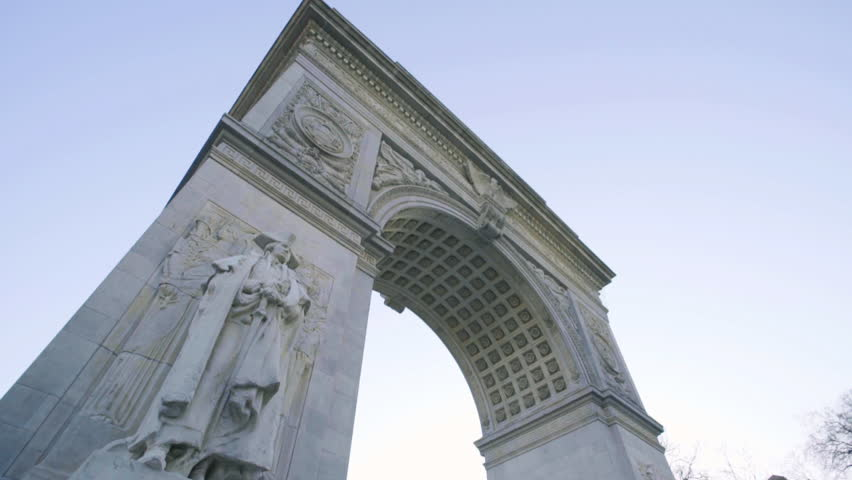 An establishing shot of the arch in Washington Square Park, located in Manhattan, New York. New York, NY - March, 2016