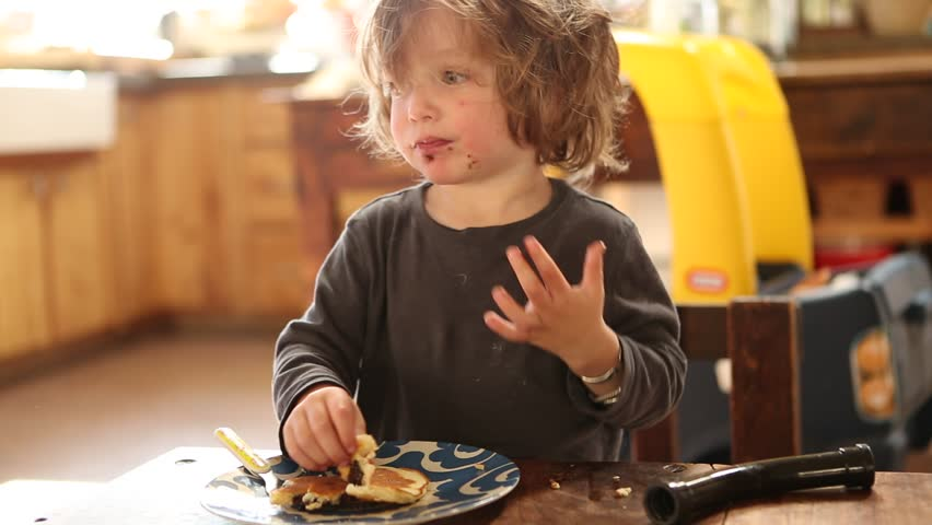 2 years old toddler boy eating breakfast. Lamy, NM : February, 2016   Shutterstock HD Video #15845830