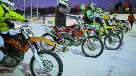 MOSCOW - FEB 14, 2015: Riders wait for race in Krylatskoe at winter evening