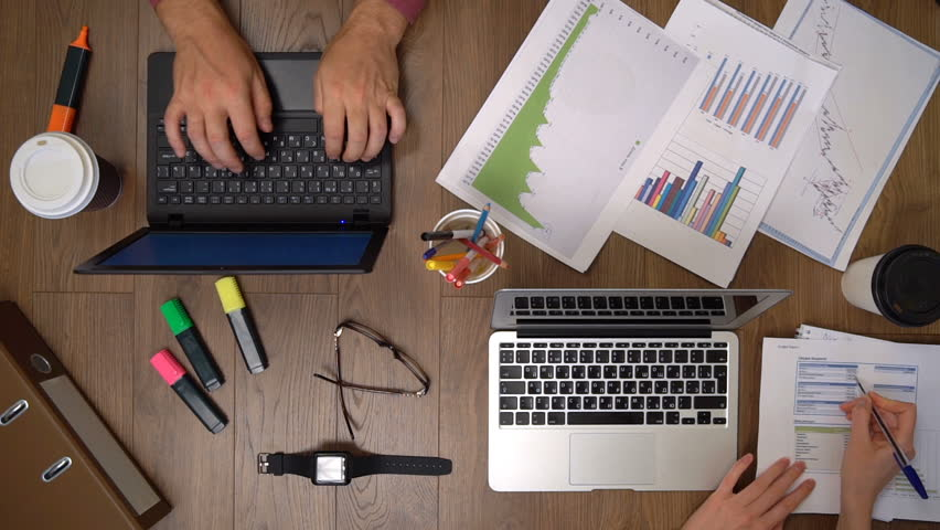 Business team working together at desk. Slow motion. The view from the top.   Shutterstock HD Video #15873385
