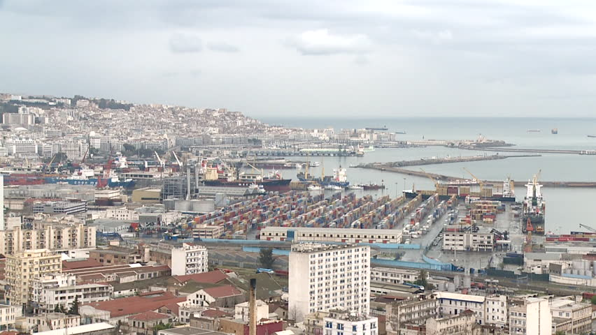 Panning long shot of Algiers cityscape and harbour