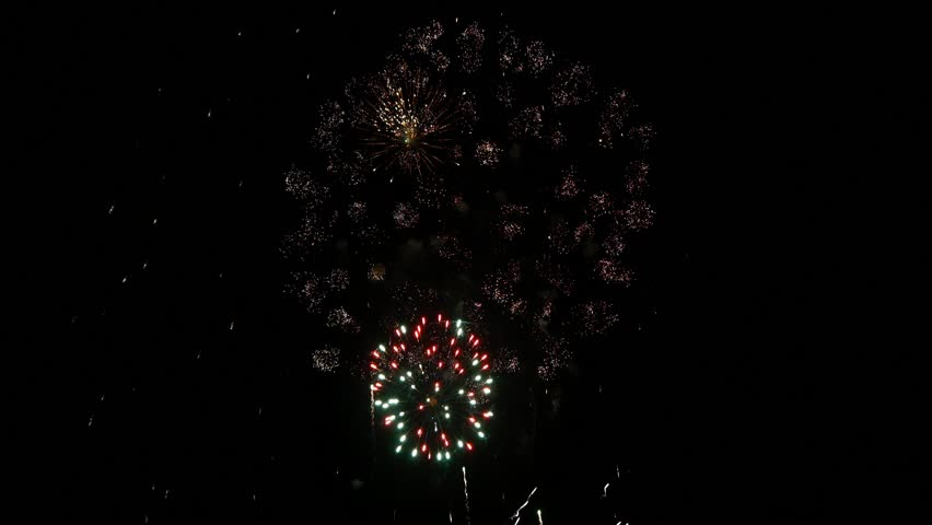 4k Fireworks display finale USA 4th of July New Year Celebration thanksgiving big colorful  fire particles in the sky, people watching and taking pictures of the show | Shutterstock HD Video #15888091