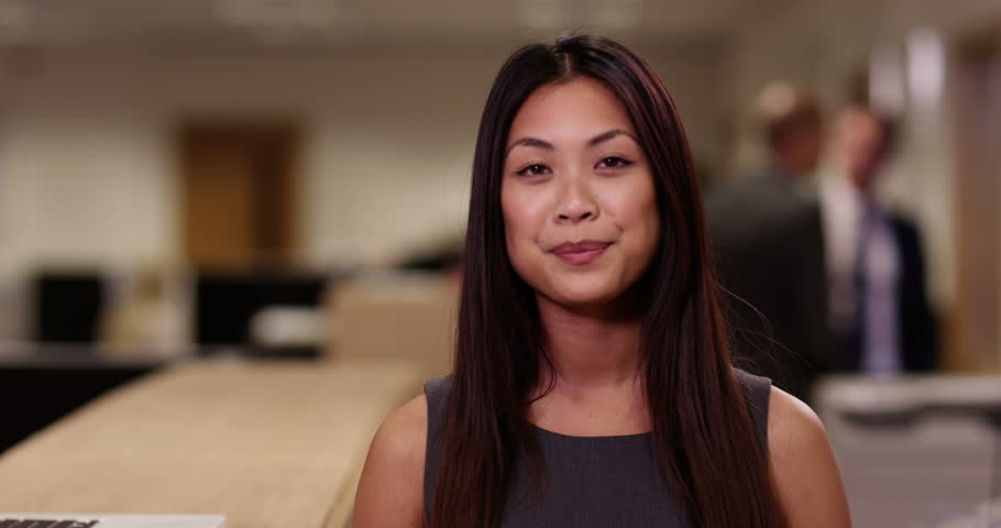 4k, Asian businesswoman nodding at the camera while having a video conference in her office. #15896392