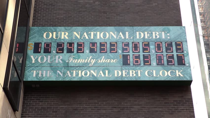 New York, New York, USA - April 13, 2016: The National Debt Clock in Midtown Manhattan. It shows the gross national debt of the United States.