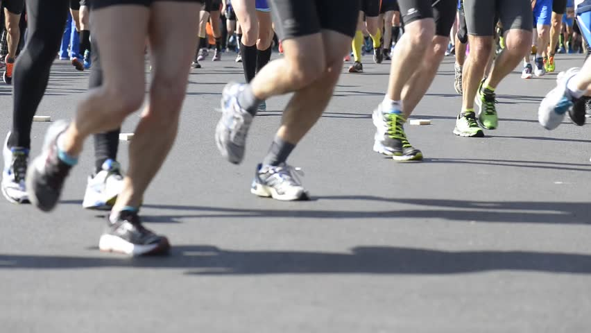Legs of runners in a marathon, blurred | Shutterstock HD Video #15903991