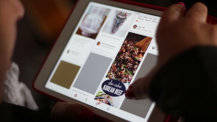 WORLDWIDE - APRIL 2016: Browsing Pinterest on Tablet