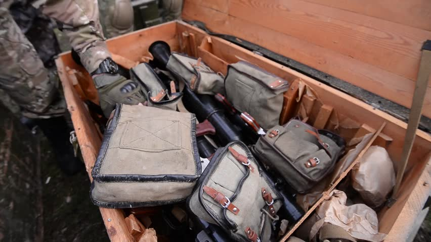 Military wooden box with weapon.Top view angle.Soldiers take grenade launchers from box