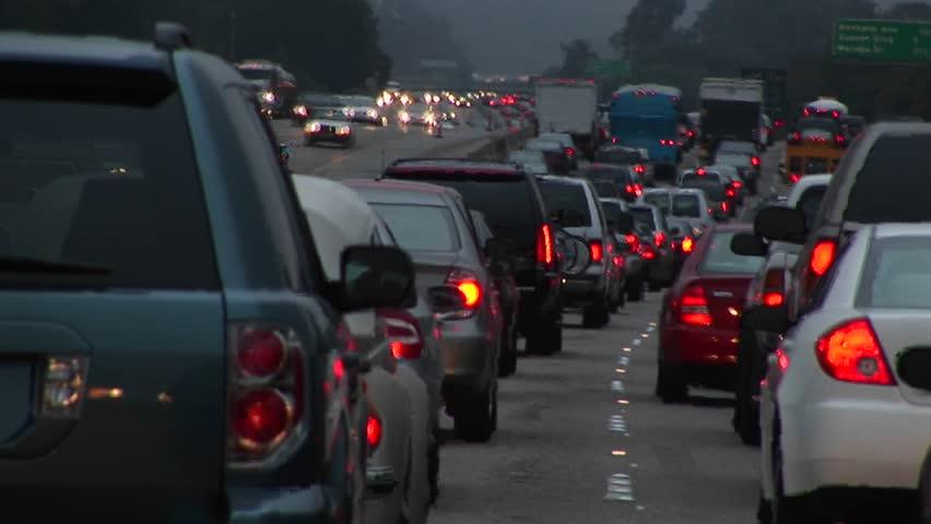 Heavy traffic drives down a freeway | Shutterstock HD Video #1592119