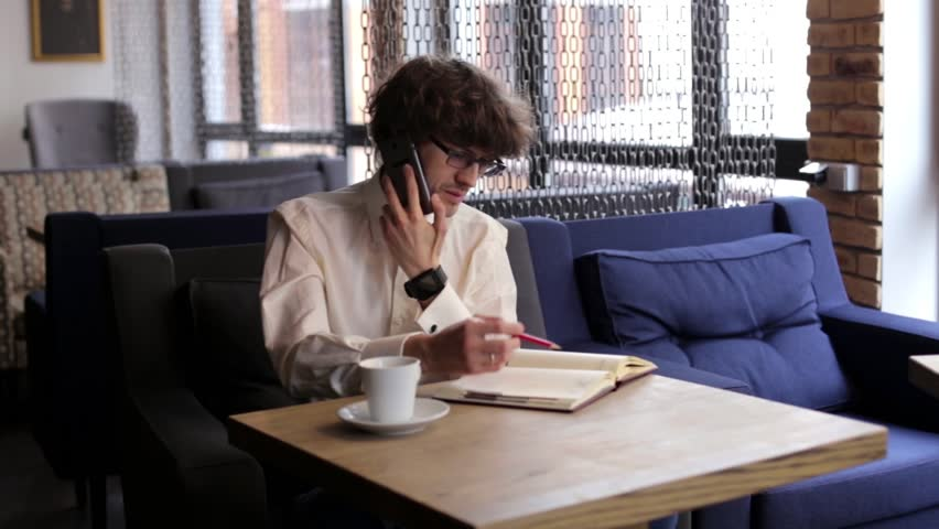 Businessman Talking on the Phone in a Cafe | Shutterstock HD Video #15931615