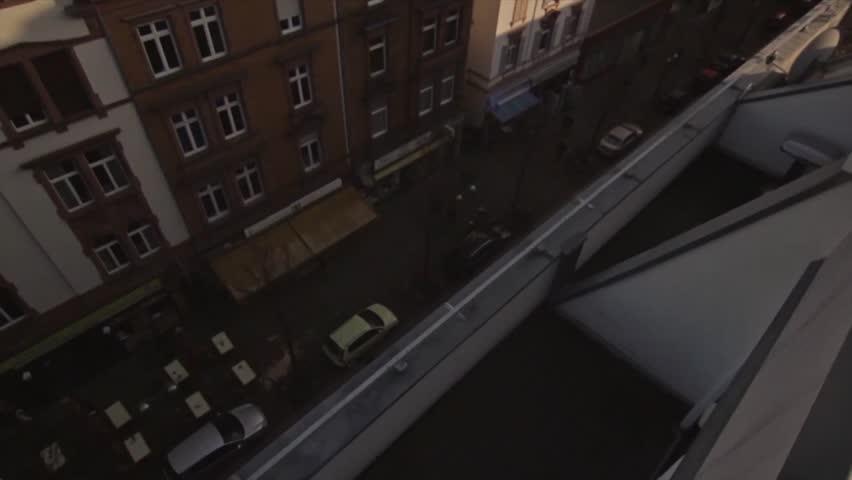Parkour Runner does long run over rooftaop in frankfurt germany.   Shutterstock HD Video #15935539