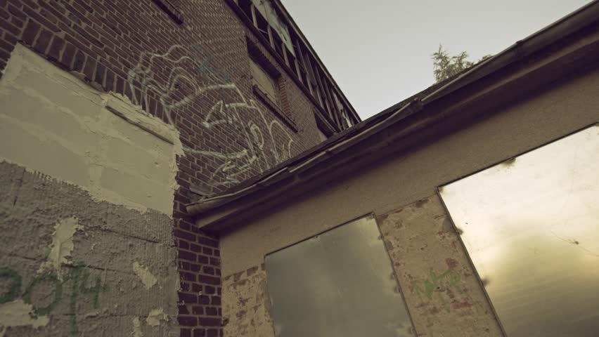 Parkour and Freerunning pro does a huge frontflip drop onto a platform.   Shutterstock HD Video #15935566
