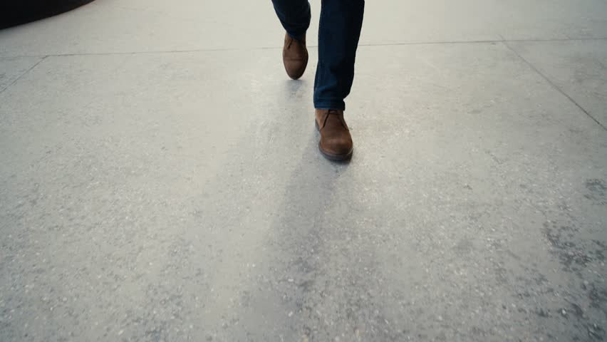 Walking on concrete : close-up view of man's leather shoes | Shutterstock HD Video #16014553