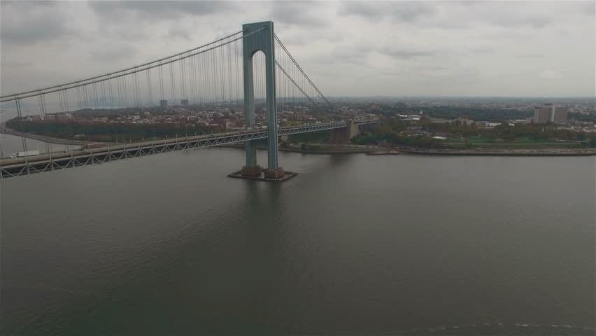 Aerial view of Verrazano–Narrows Bridge. Camera moving towards the bridge, Brooklyn bank seen.    Shutterstock HD Video #16020814