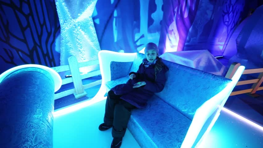 MOSCOW - DEC 20, 2014: Girl sits (with model release) on couch in Grandfather Frost house in pavillion of VDNKh | Shutterstock HD Video #16021510