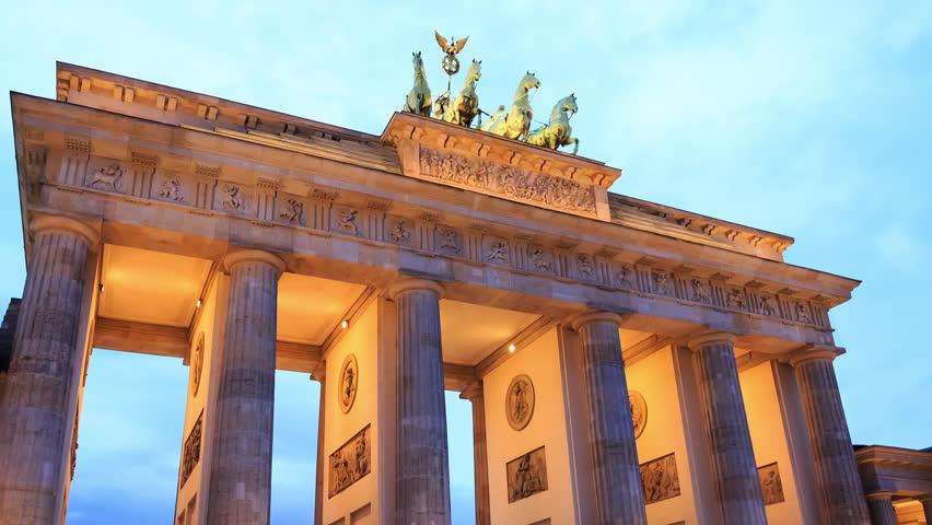 Hyperlapse closeup or motion time lapse of the Brandenburg Gate Landmark (Brandenburger Tor) by Pariser Platz in Berlin, Germany at night. 4k (4096x2304).  Relevant to coronavirus, covid-19.