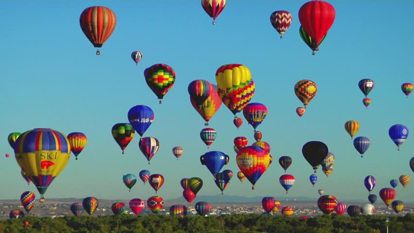 ALBUQUERQUE, NM - CIRCA 2009: Hot air balloons rise against a blue sky at the Albuquerque Balloon Festival circa 2009 in Albuquerque.